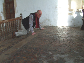 Clive inspecting a tiled church floor.